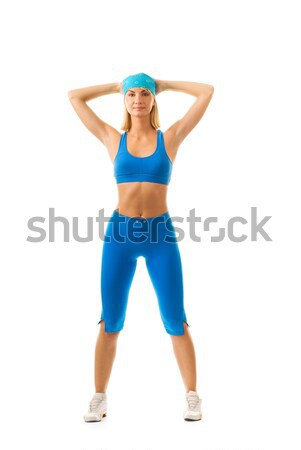Beautiful young woman doing fitness exercise isolated on white b Stock photo © Nejron