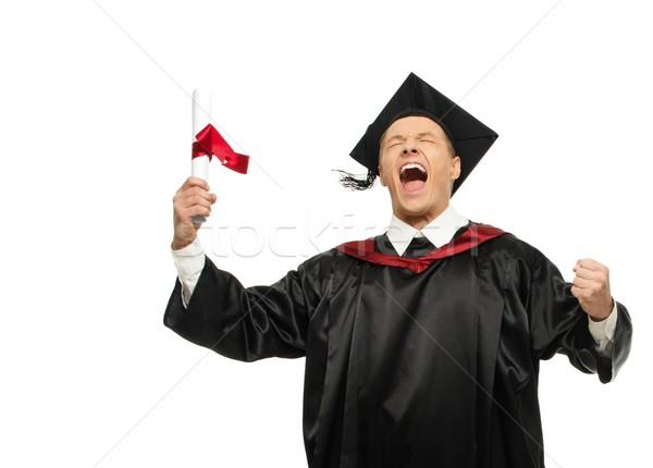 Funny happy young graduated student man isolated on white  Stock photo © Nejron
