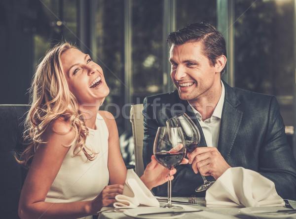 Stock fotó: Derűs · pár · étterem · szemüveg · vörösbor · lány