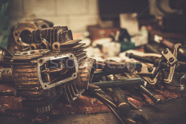 Part of motorcycle engine on a table in workshop Stock photo © Nejron