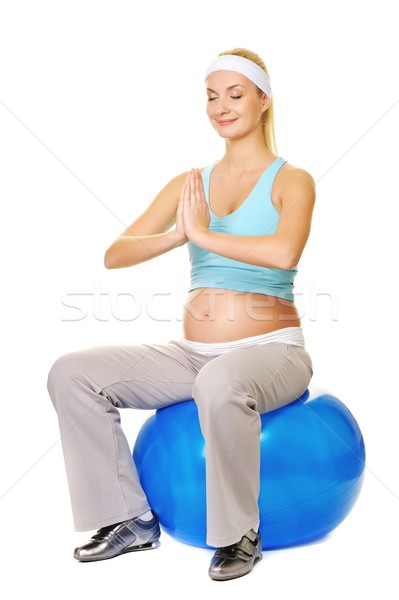Young pregnant woman making exercise on a fitness ball   Stock photo © Nejron