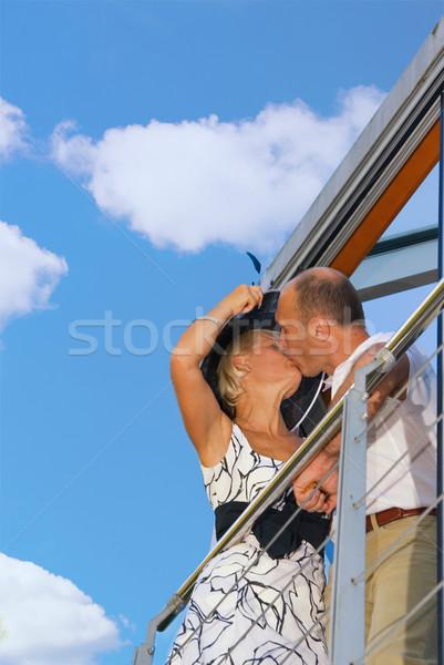 Сток-фото: пару · целоваться · балкона · женщину · небе