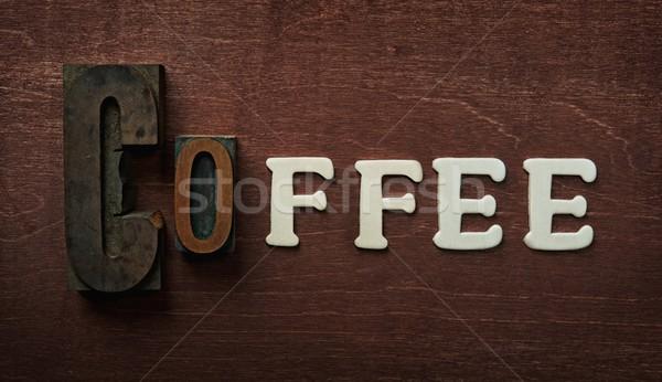 The word coffee written on wooden background Stock photo © Nejron
