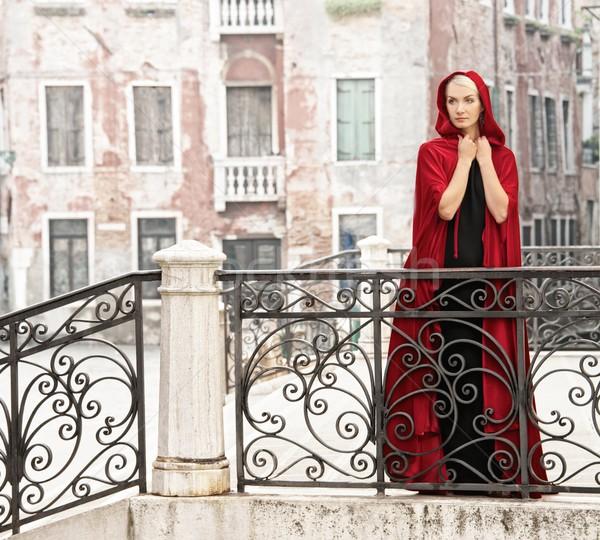 Gyönyörű nő piros köpeny híd víz város Stock fotó © Nejron