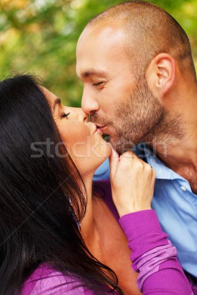 Happy smiling middle-aged couple outdoors Stock photo © Nejron