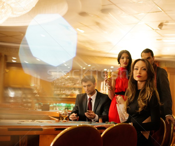 Group of young people behind roulette table in a casino Stock photo © Nejron
