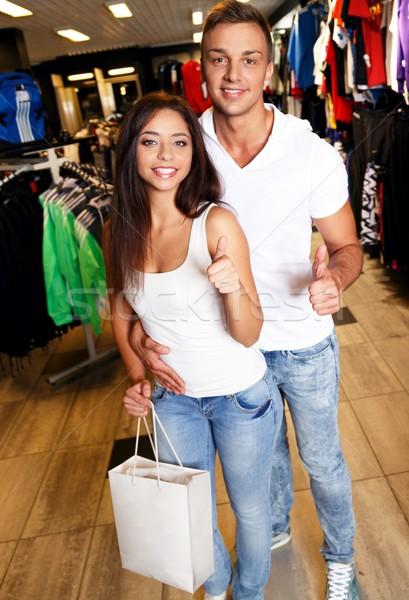 Happy young couple with shopping bag in sportswear store Stock photo © Nejron