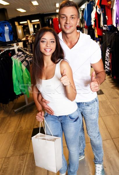 Boldog fiatal pér bevásárlószatyor sportruha bolt nő Stock fotó © Nejron