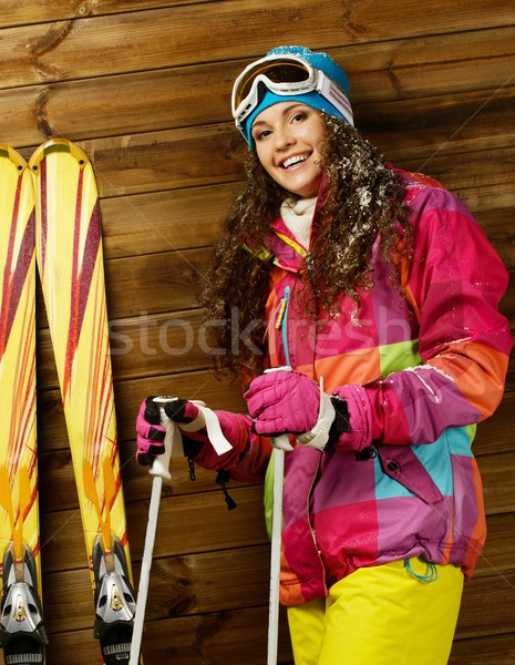Smiling woman with skies and poles standing against wooden house wall  Stock photo © Nejron