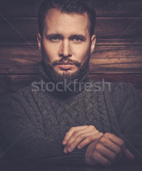 Homem bonito cardigã rural casa interior Foto stock © Nejron