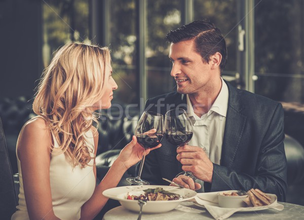 Cheerful couple in a restaurant with glasses of red wine Stock photo © Nejron