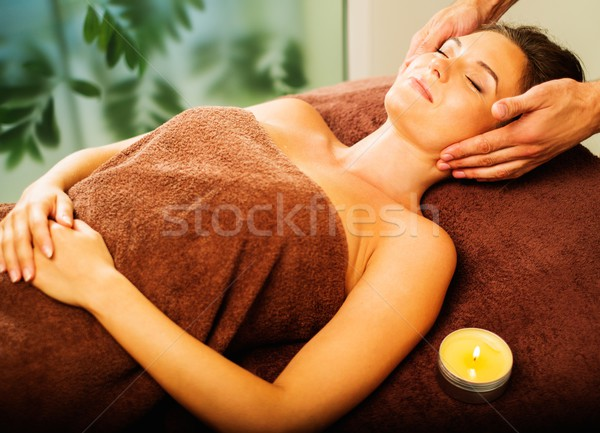 Stock photo: Young woman having face massage in a spa salon