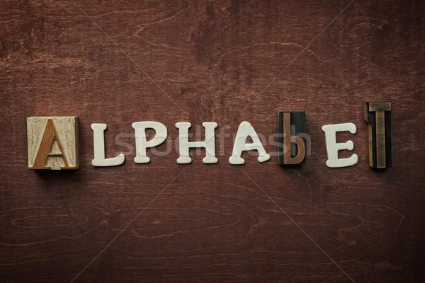 The word alphabet written on wooden background Stock photo © Nejron