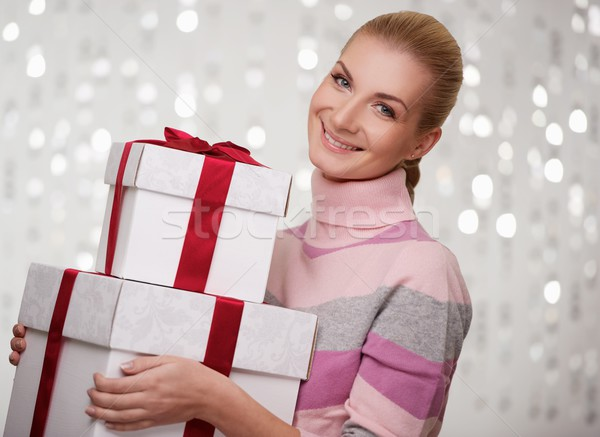 Smiling woman in cashmere sweater with gift boxes. Stock photo © Nejron