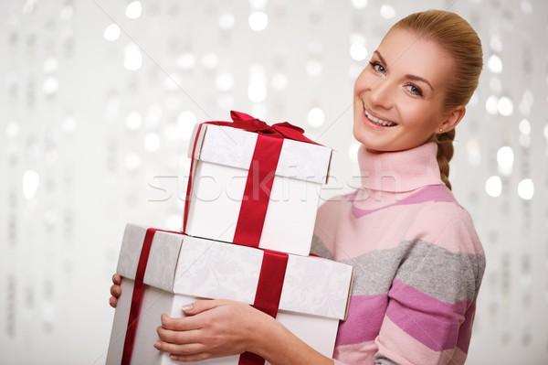 Smiling woman in cashmere sweater with gift boxes Stock photo © Nejron