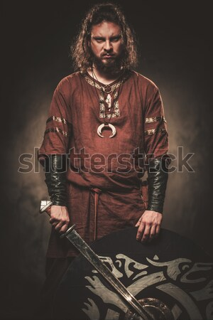Smiling medieval knight  holding helmet Stock photo © Nejron