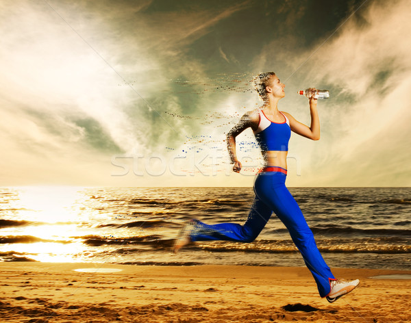 Beautiful young woman running on a beach (with dynamic distortio Stock photo © Nejron