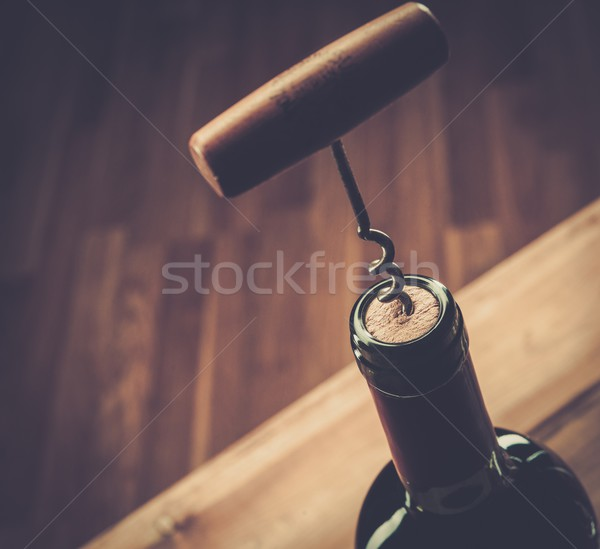 Opening wine bottle with a corkscrew  Stock photo © Nejron