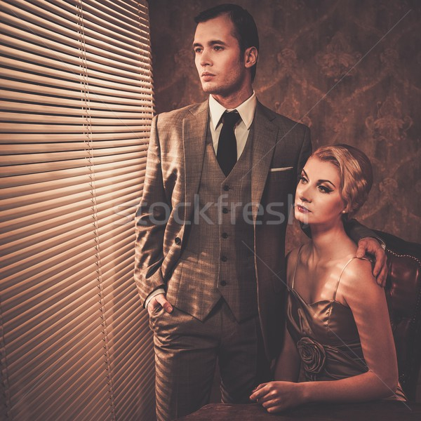 Retro couple near a window Stock photo © Nejron