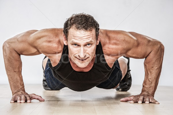 Middle-aged muscular man doing push-up Stock photo © Nejron