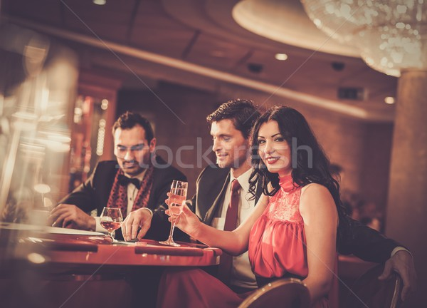 People behind poker table in a casino Stock photo © Nejron
