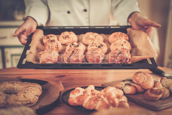 Cook hands holding baking tray with homemade baked goods Stock photo © Nejron
