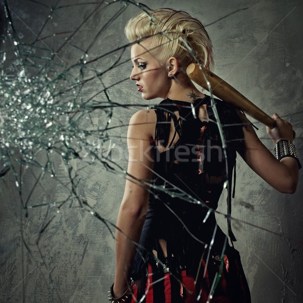 Punk girl with a bat behind broken glass Stock photo © Nejron