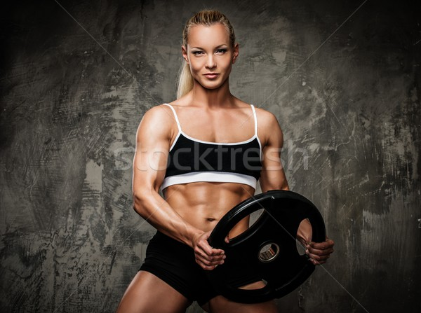 Beautiful muscular bodybuilder woman with weights  Stock photo © Nejron