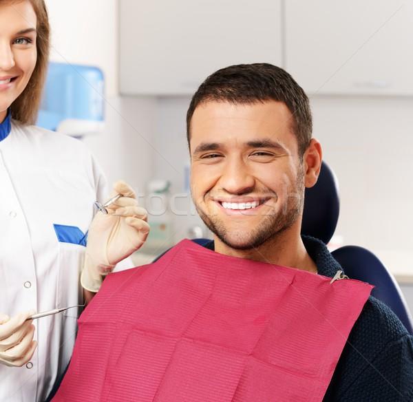 Feliz homem paciente sorrindo dentista cirurgia dentária Foto stock © Nejron