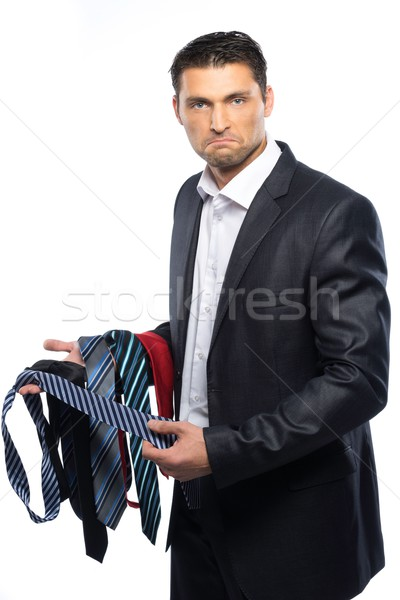 Bewildered handsome man in black suit and choice of ties  Stock photo © Nejron