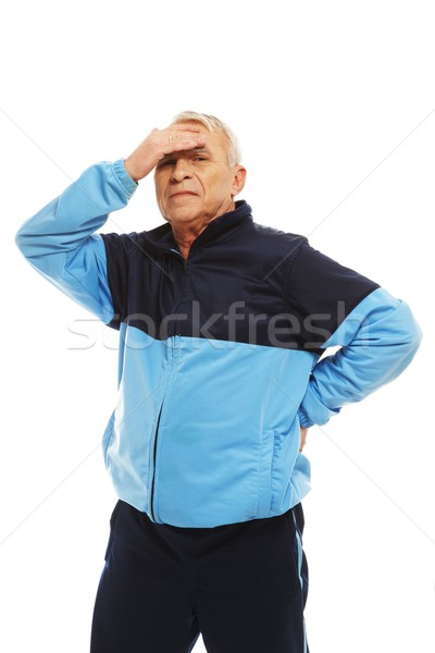 Senior man in training suit feeling headache migraines  Stock photo © Nejron