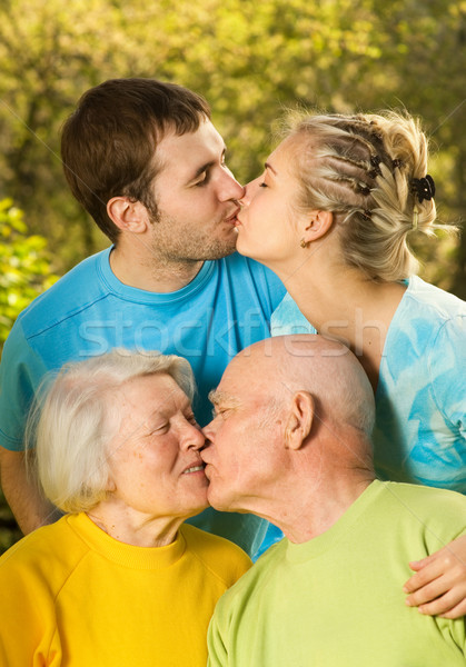 Young and senior couples kissing outdoors Stock photo © Nejron