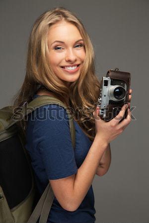 Bella donna sorridente fotocamera digitale isolato bianco mano Foto d'archivio © Nejron