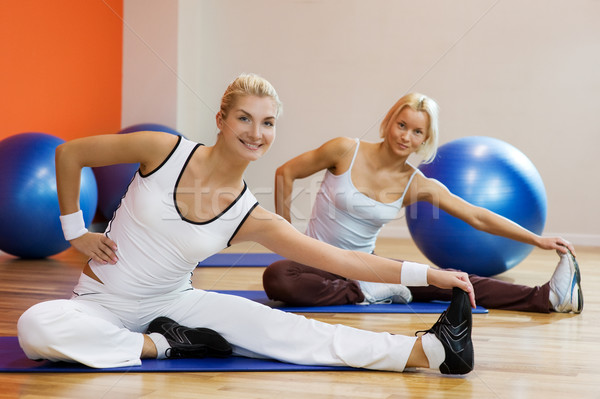 Group of people doing stretching exercise Stock photo © Nejron