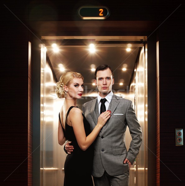 Retro couple standing against elevator. Stock photo © Nejron