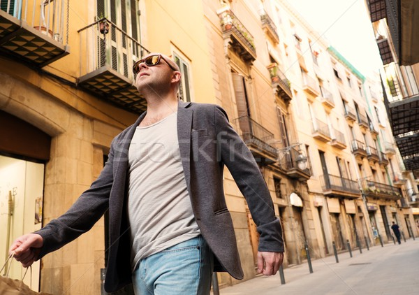 Middle-aged man with shopping bag walking outdoors Stock photo © Nejron