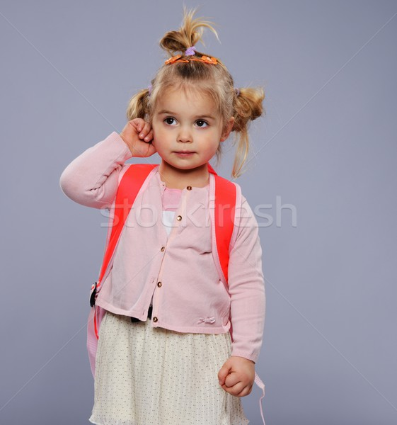 Grappig weinig schoolmeisje rugzak geïsoleerd grijs Stockfoto © Nejron