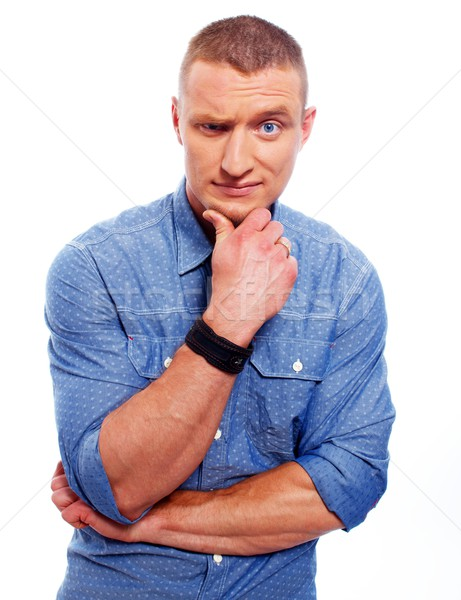 Funny suspicious man in blue shirt isolated on white background  Stock photo © Nejron