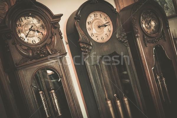 Three vintage wooden floor  clocks Stock photo © Nejron