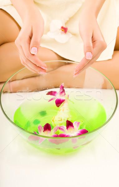 Girl washing hands in aroma water Stock photo © Nejron