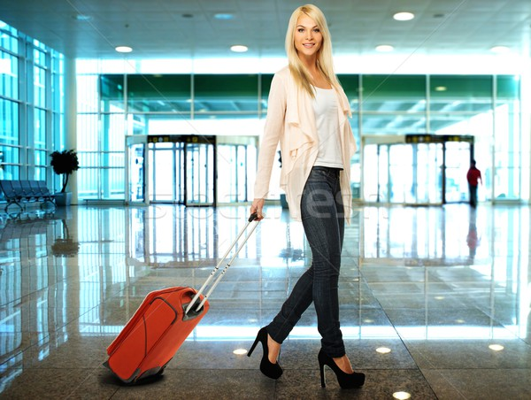 Blond woman with suitcase in airport  Stock photo © Nejron