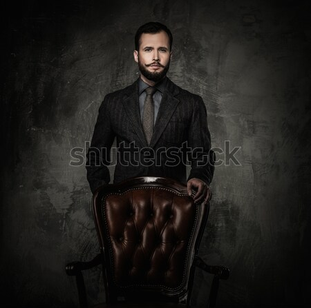 Handsome well-dressed  standing leather chair  Stock photo © Nejron