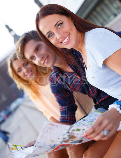 Three friends tourist with map outdoors  Stock photo © Nejron