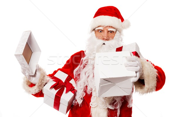 Surprised Santa Claus with opened gift box isolated on white background  Stock photo © Nejron