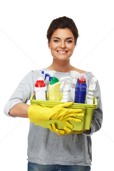 Beautiful cheerful brunette woman in gloves holding different cleaning stuff  Stock photo © Nejron
