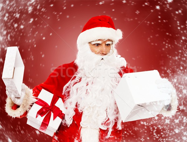 Surprised Santa Claus with opened gift box   Stock photo © Nejron