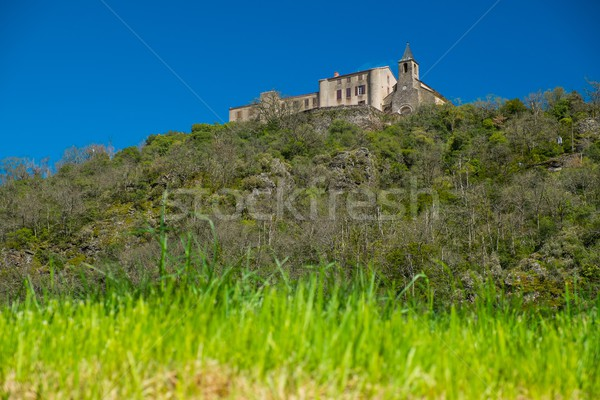 Belfry on a hill in old village Ambialet, France  Stock photo © Nejron