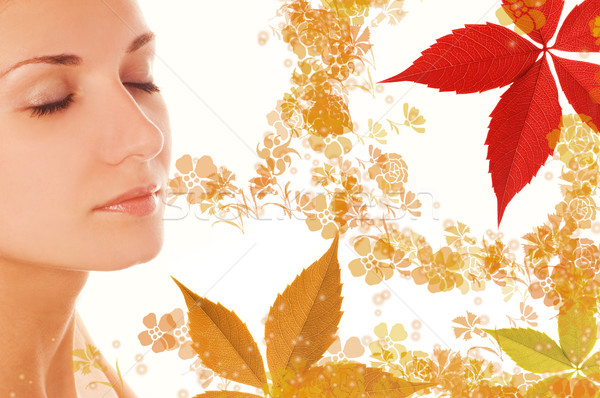 Beautiful girl's face and colorful autumn leaves around her Stock photo © Nejron