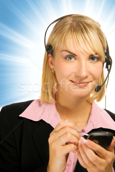 Beautiful hotline operator with cellphone in her hands on abstra Stock photo © Nejron