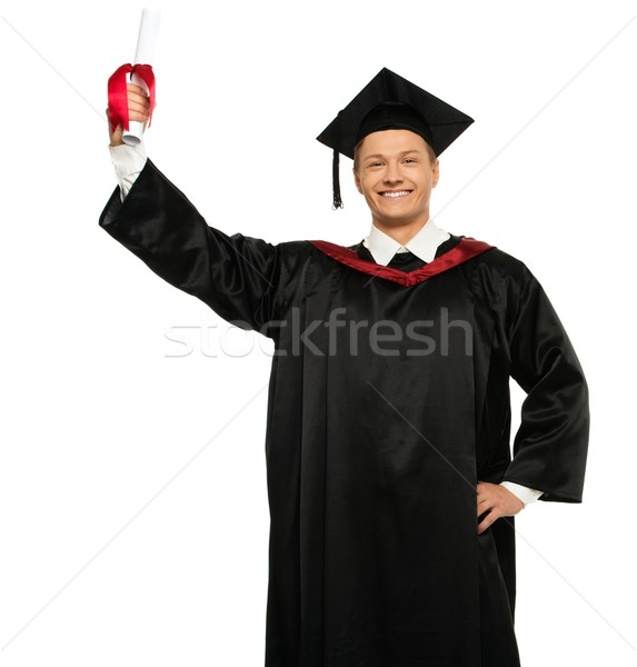 Cheerful young graduated man isolated on white  Stock photo © Nejron